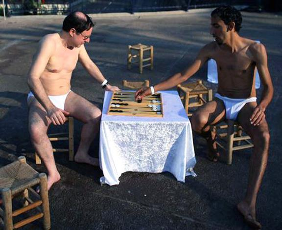Men playing backgammon in underpants