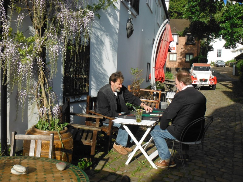 The author playing Steve Carder outside The Drawing Room in Chesham