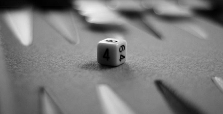 Doubling cube on a backgammon board